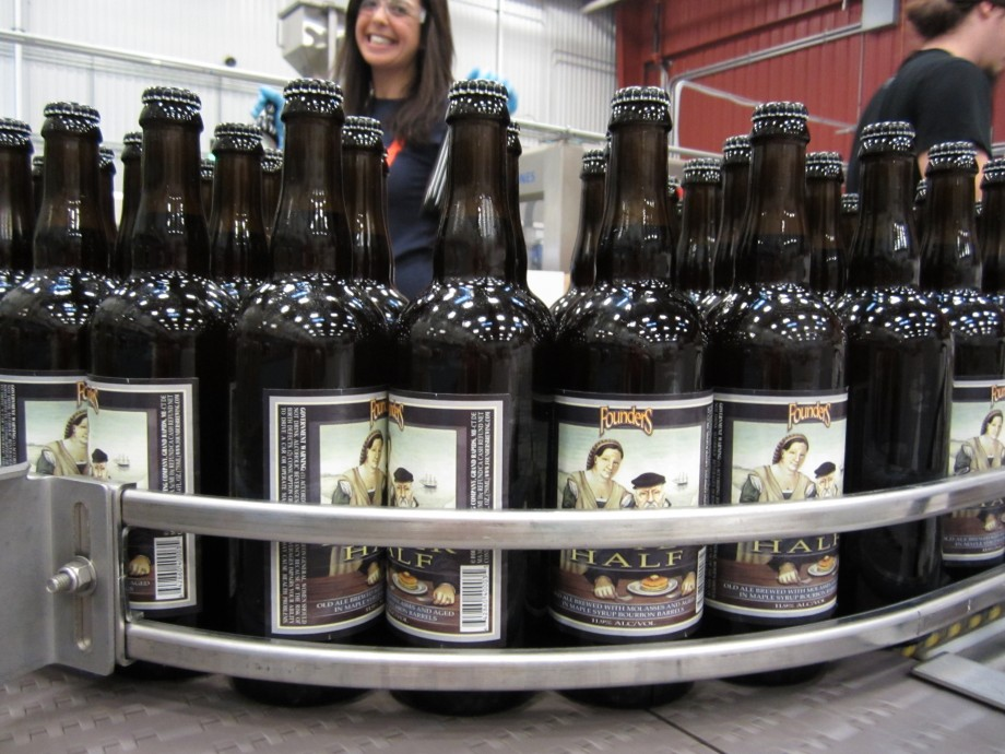 Founders Curmudgeon's Better Half bottles on assembly line