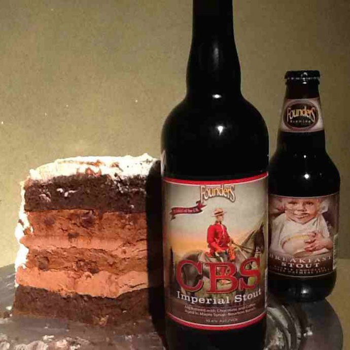 Two bottles of Founders beer with slice of cake