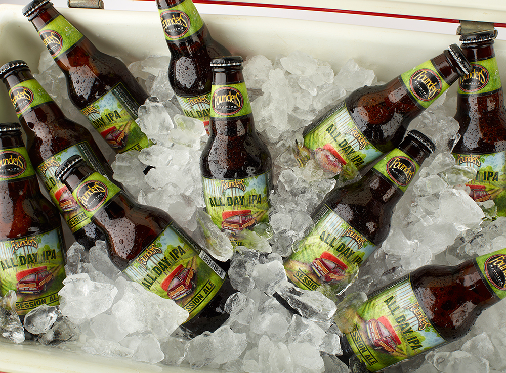 All Day IPA bottles on ice in a red Coleman cooler