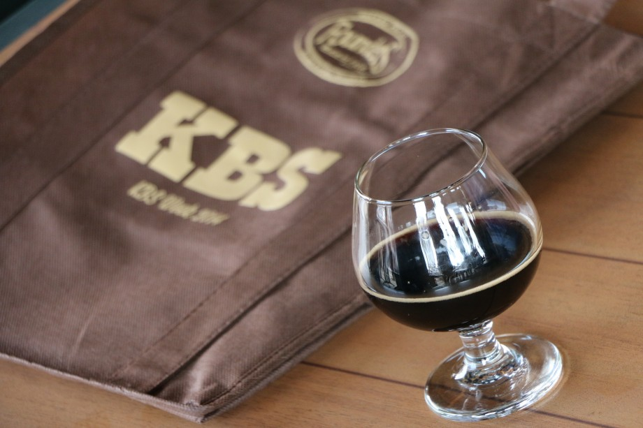 A small pour of KBS in front of a KBS Week bag