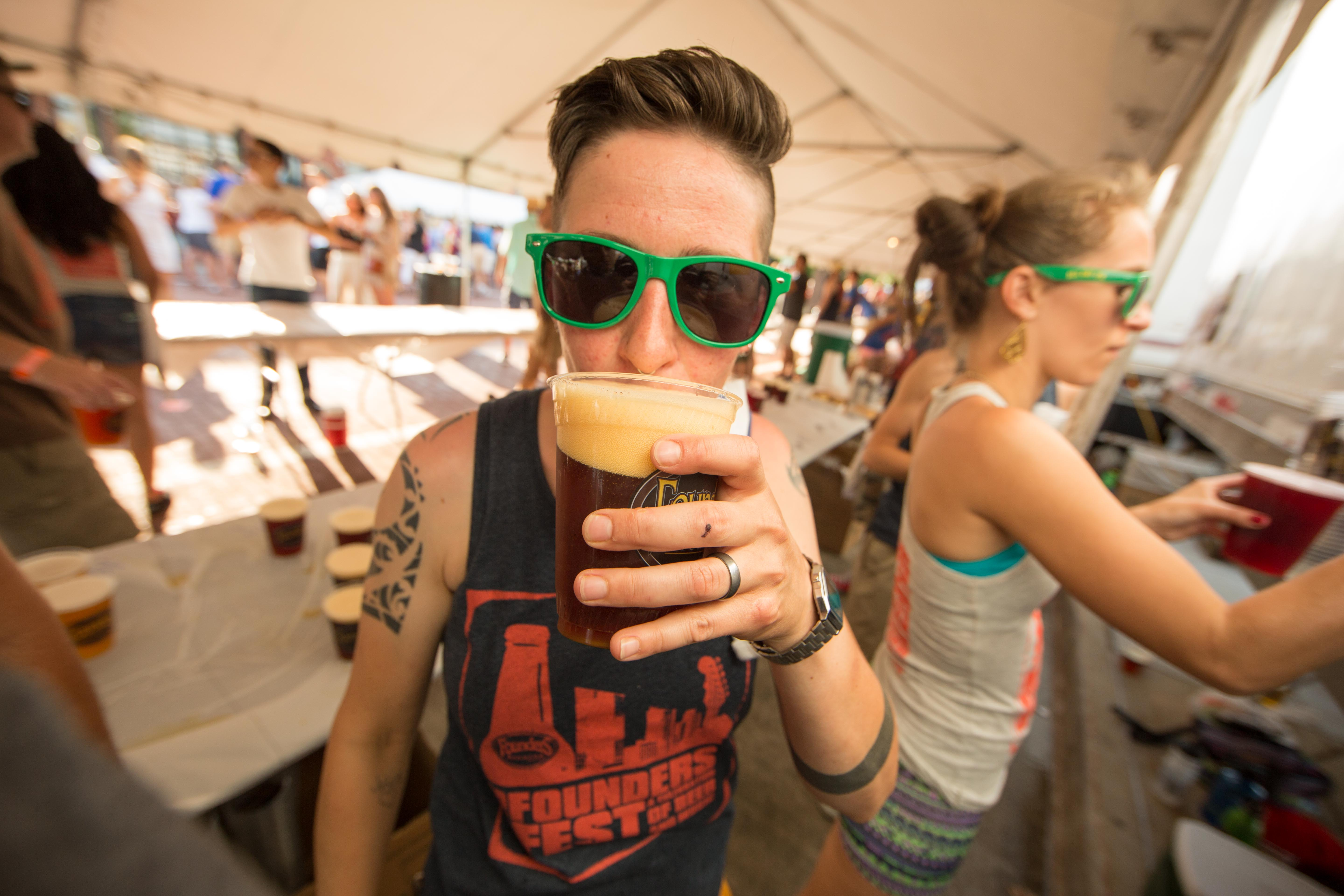 Person drinking Founders beer at Founder's Fest