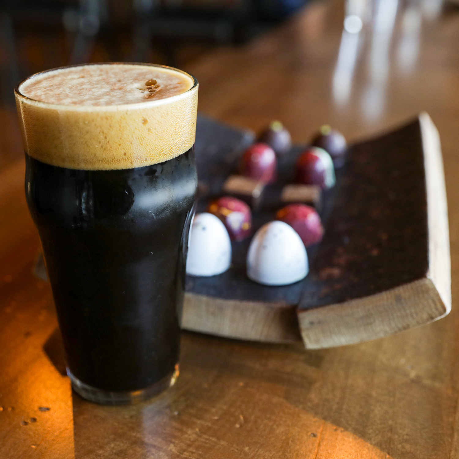 Founders Breakfast Stout with pieces of chocolate on the bar