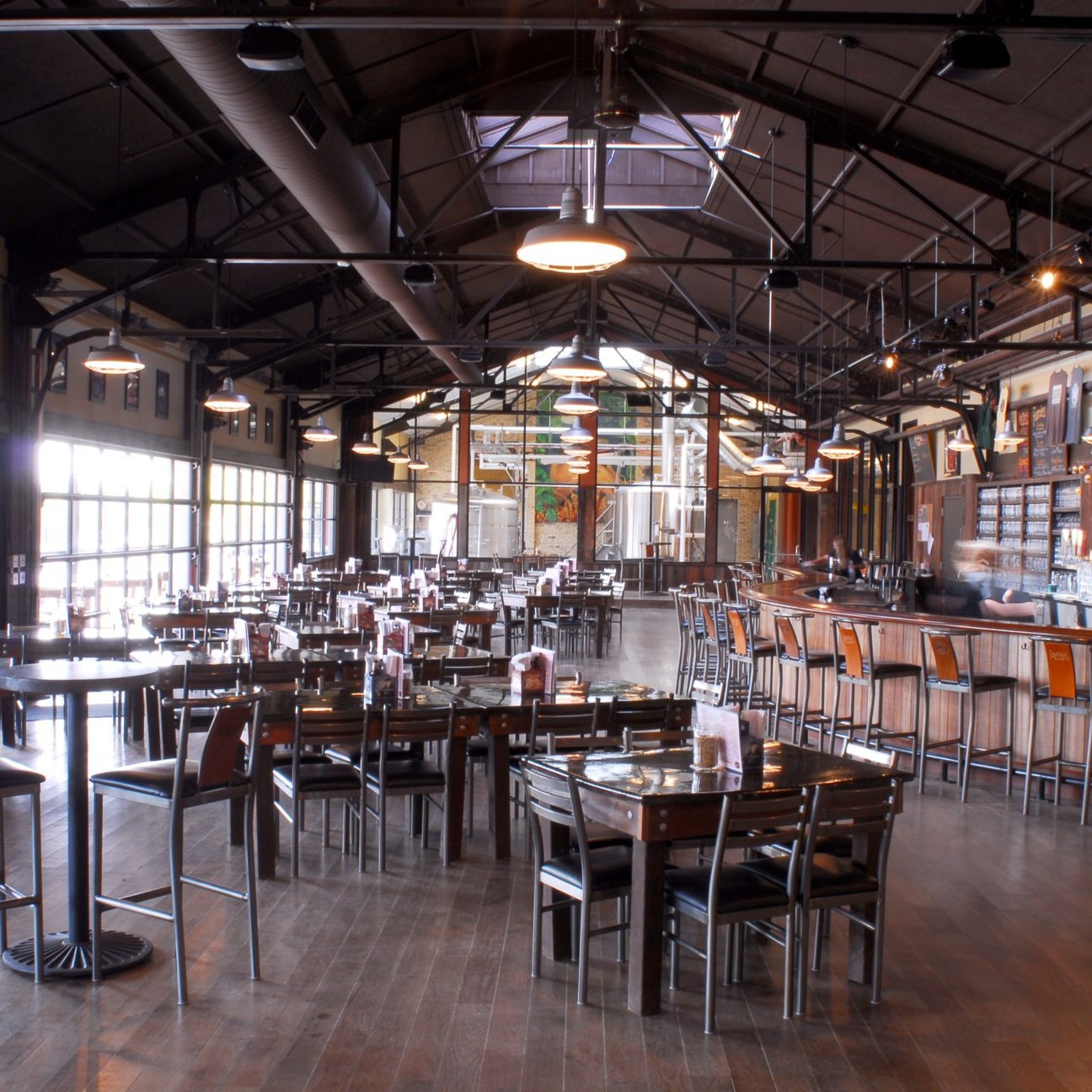 Founders Grand Rapids taproom interior looking south showing tables and chairs and a bar to the right