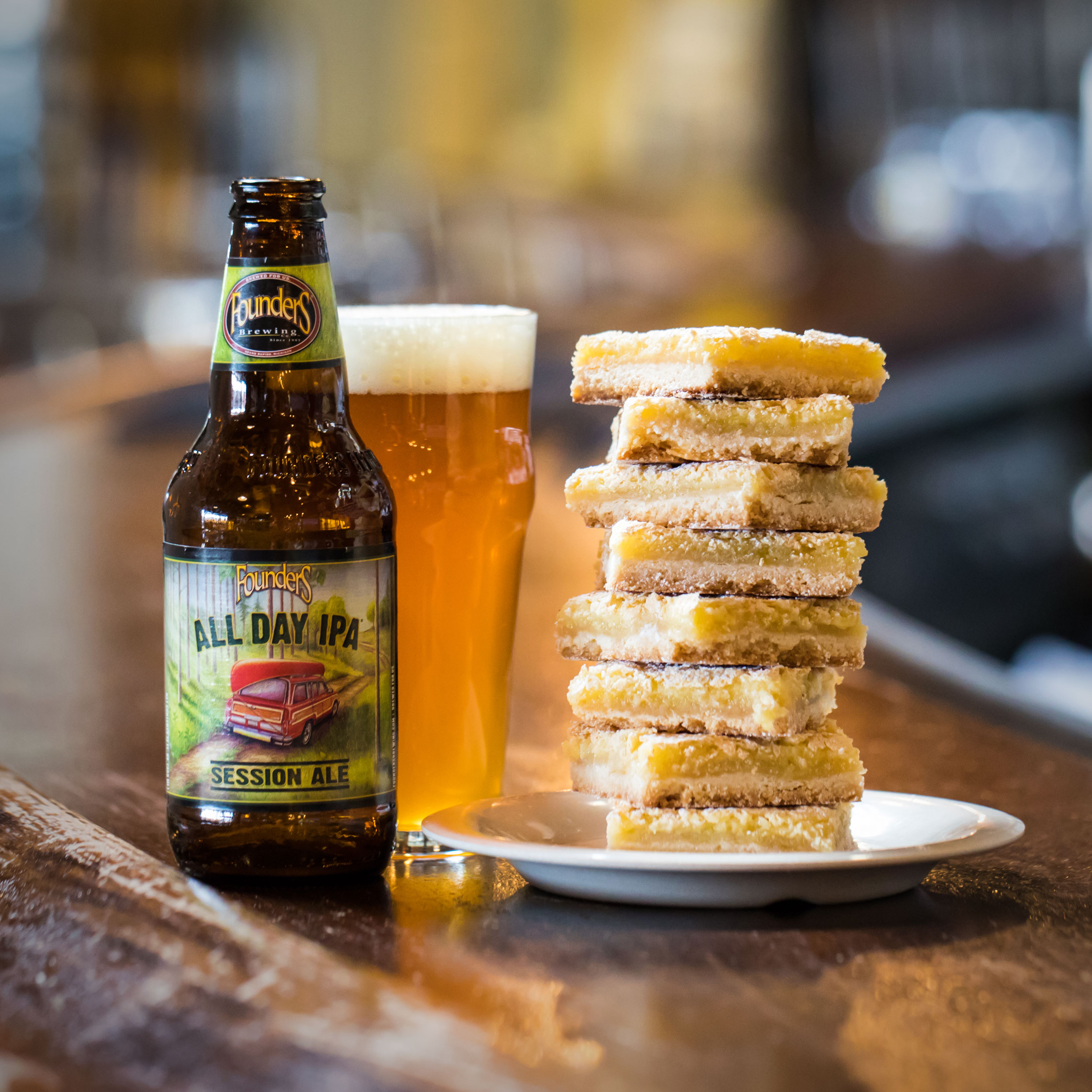 Founders All Day IPA with stack of lemon bars on the bar
