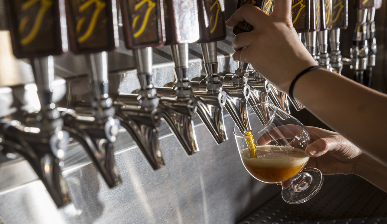 Close up of woman pouring a draft beer
