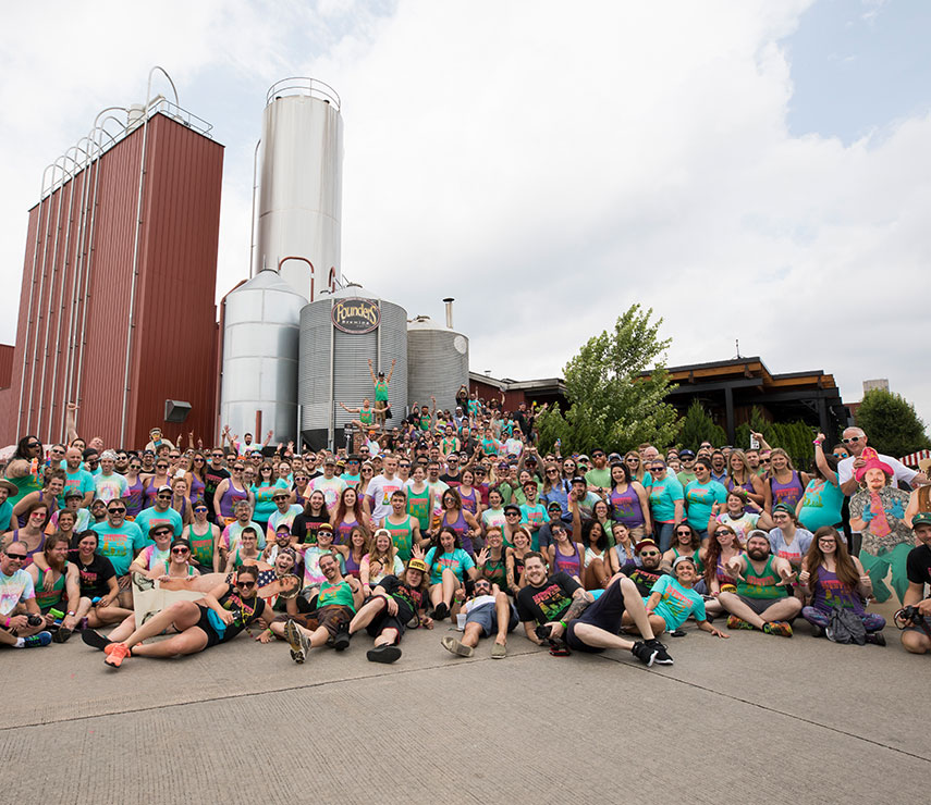 Large group of people posing in front of Founder's taproom