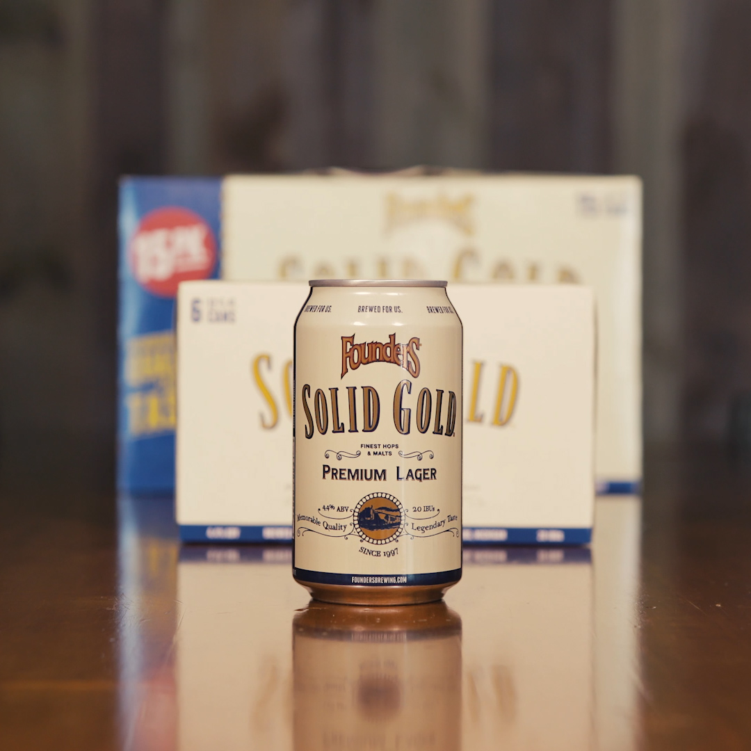 Founders Solid Gold Premium Lager beer can in front of case