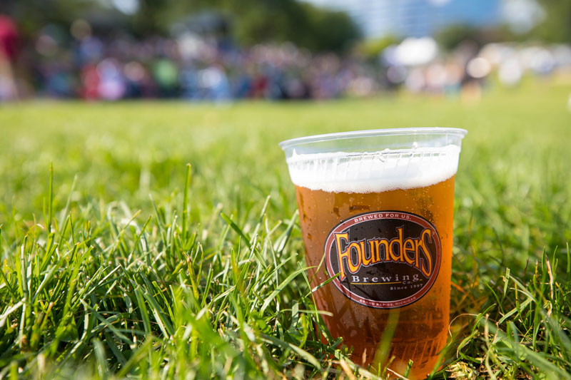 Cup of Founders beer in grass