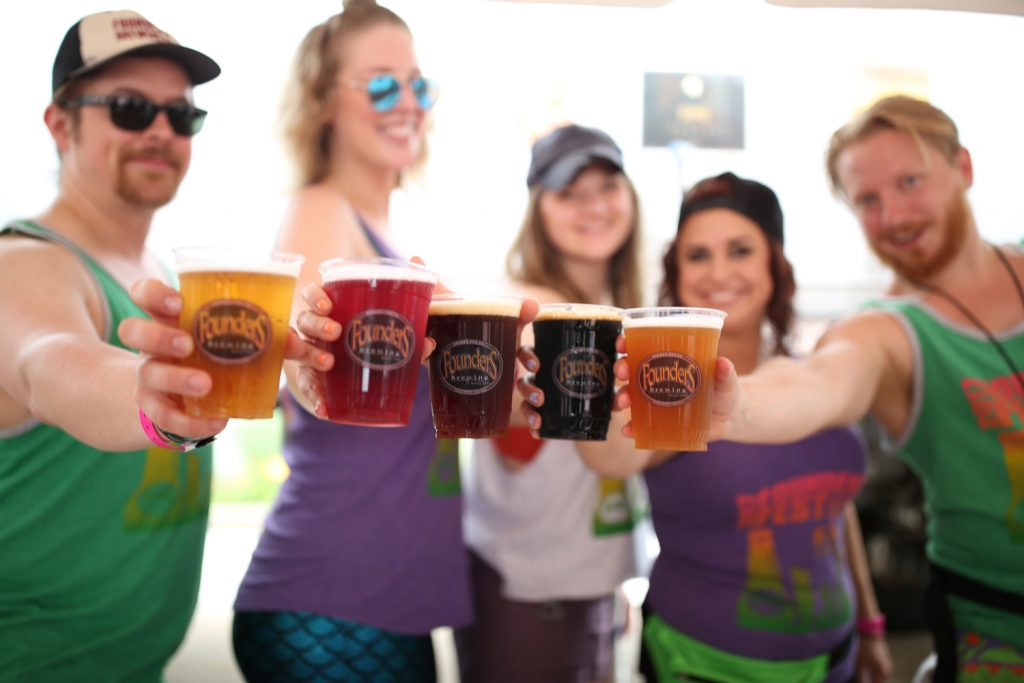 Group of people holding cups of Founders beer