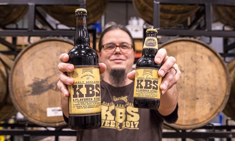 Man holding bottles of Founders KBS