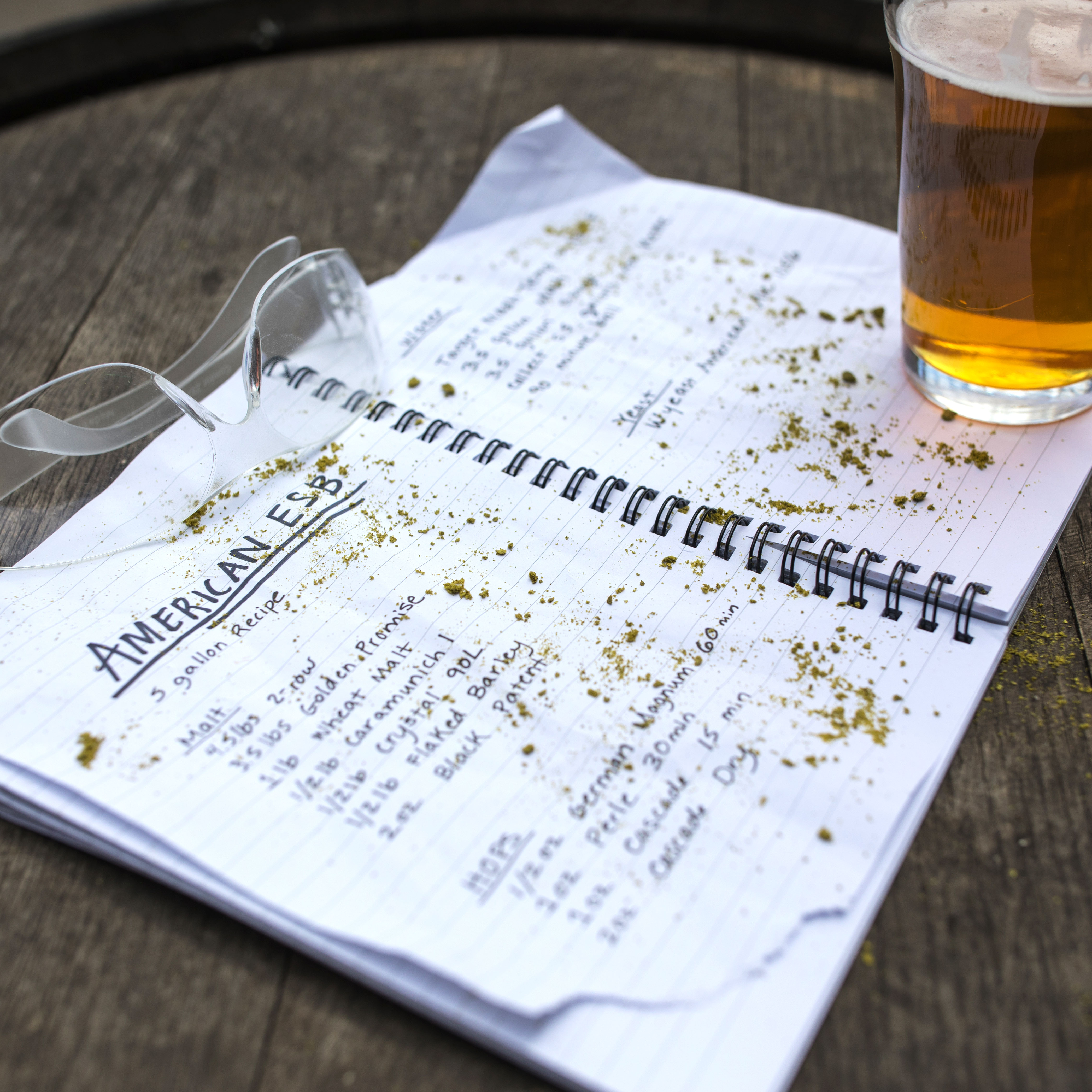 Notebook with recipe and glass of beer