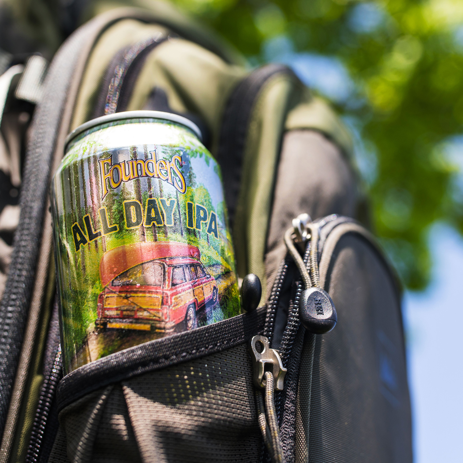 Can of Founders All Day IPA in backpack