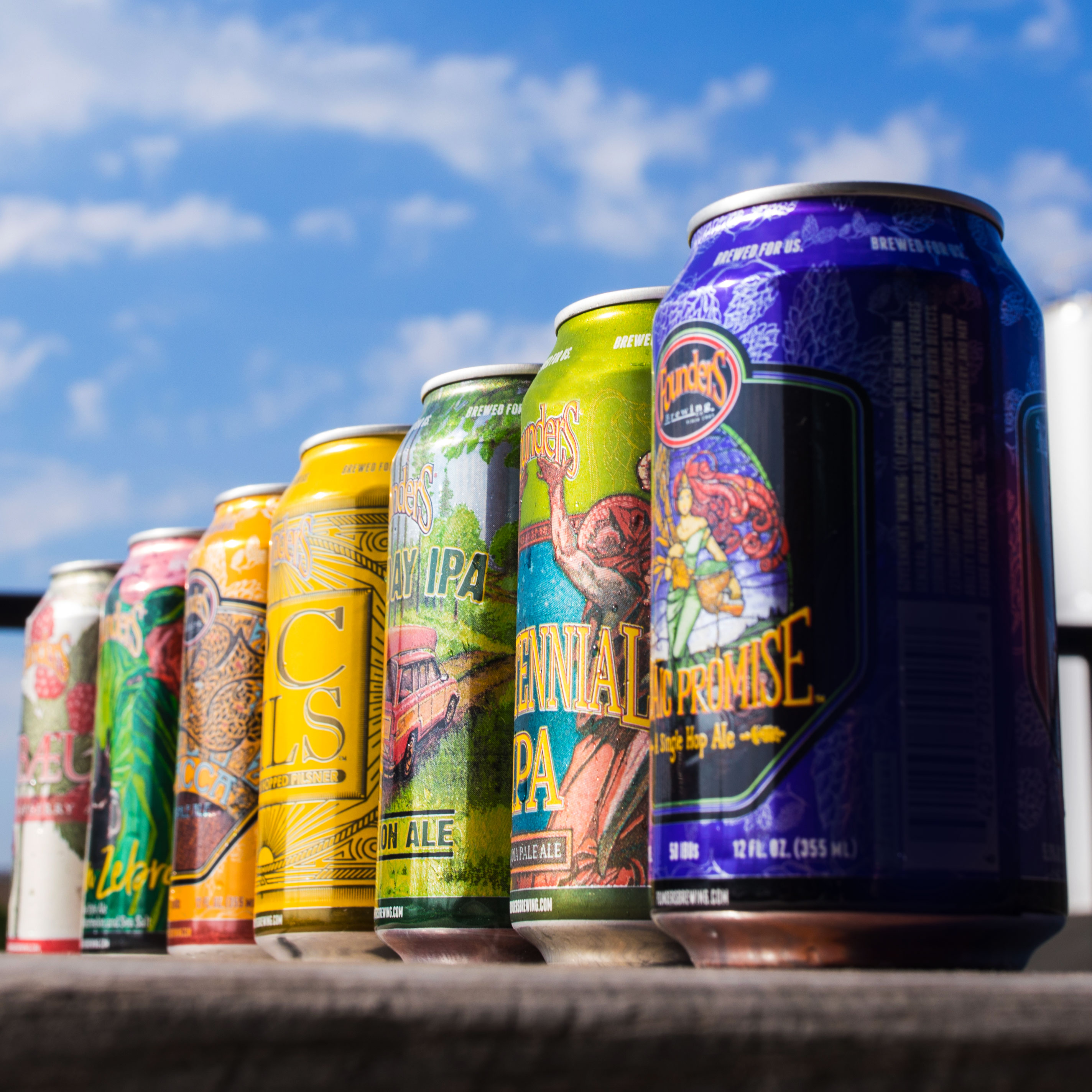 Cans of Founders beer sitting on ledge
