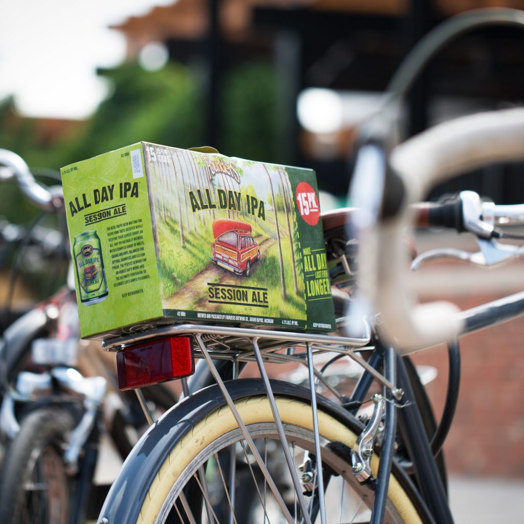 15 pack of Founders All Day IPA sitting on bike