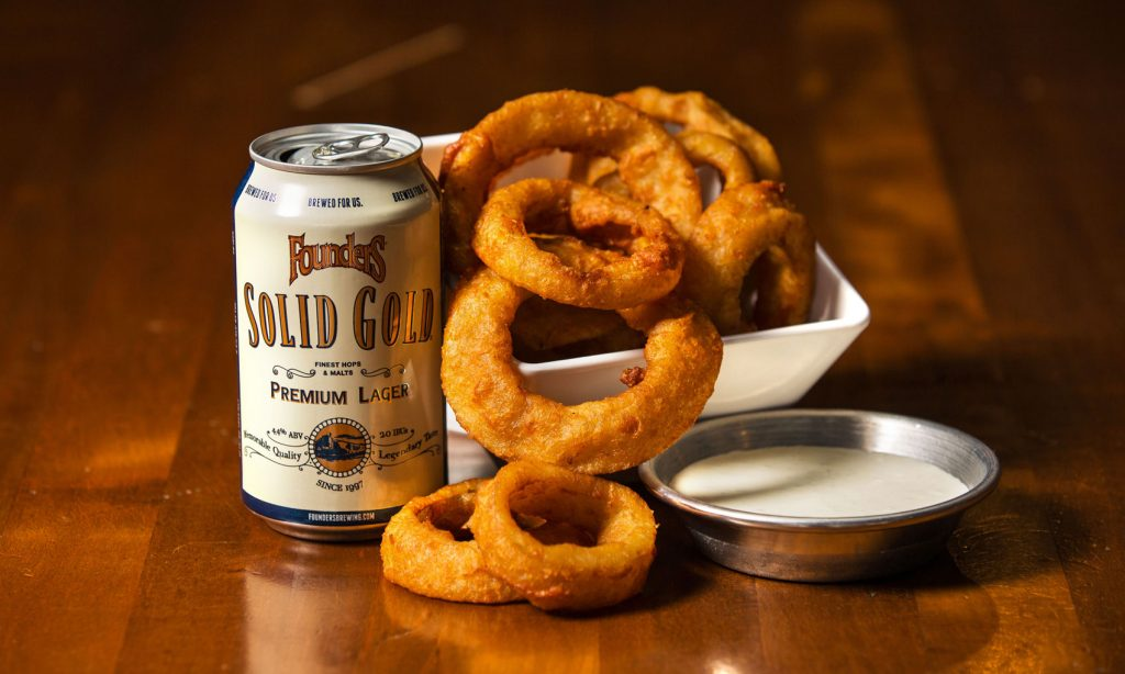 Can of Founders Solid Gold with onion rings