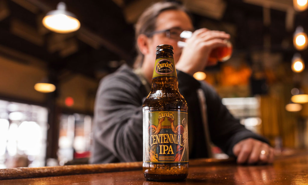 Man drinking Founders Centennial IPA