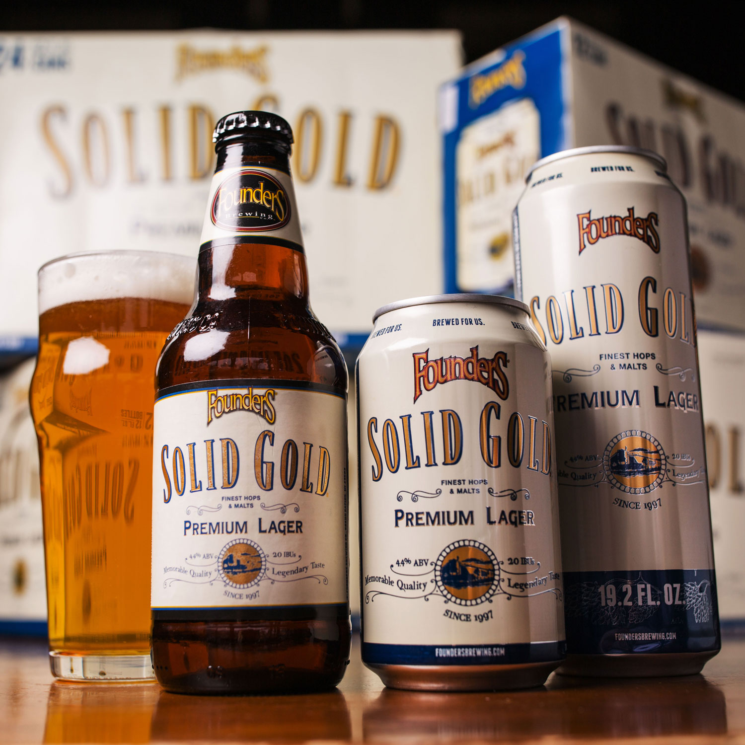 Glass, bottle, cans of Founders Solid Gold