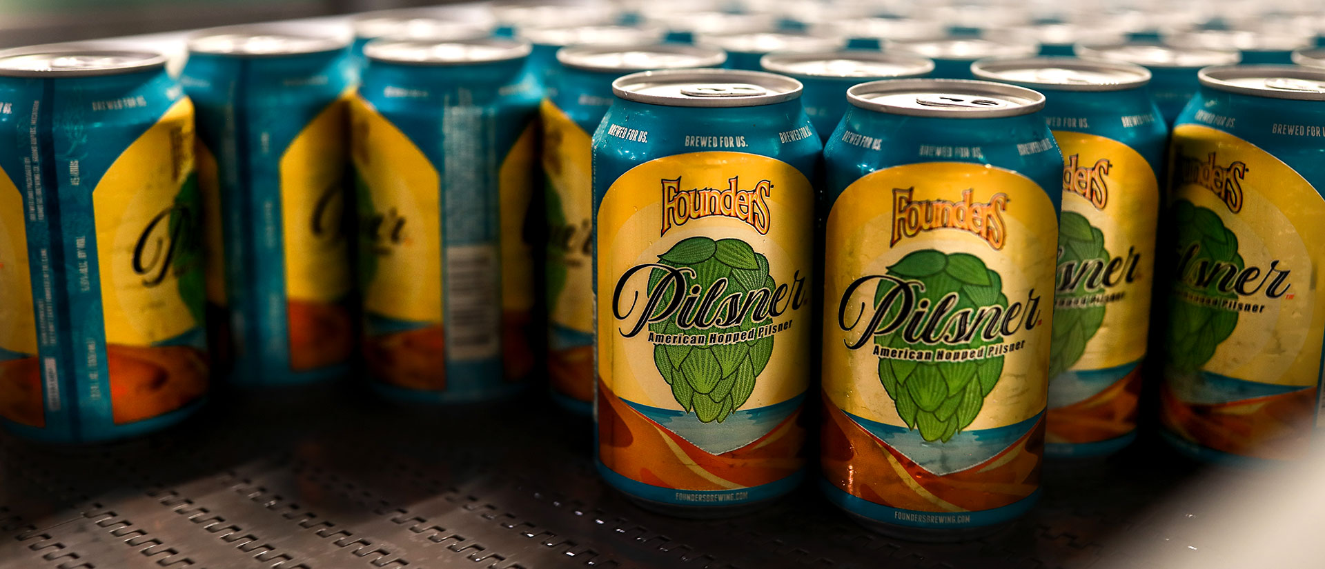 Cans of Founders Pilsner