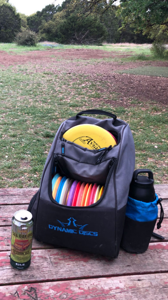 Backpack of disc golf materials and Founders All Day IPA