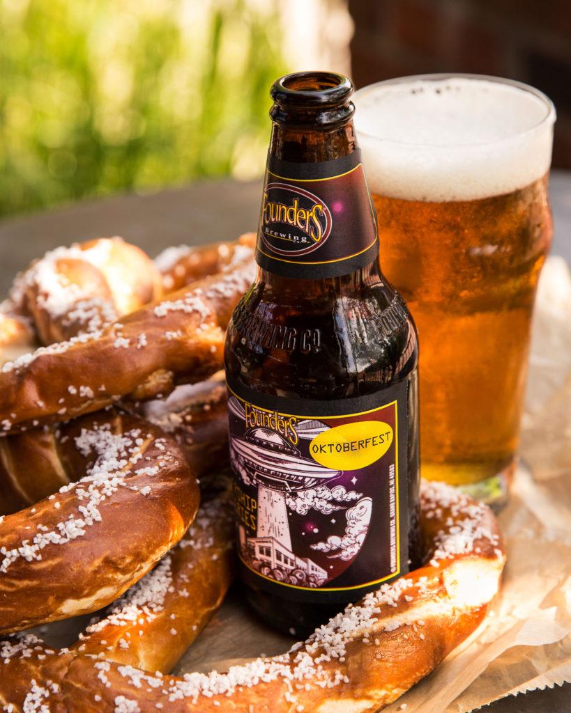 Bottle of Founders Mothership Series Oktoberfest with beer pretzels