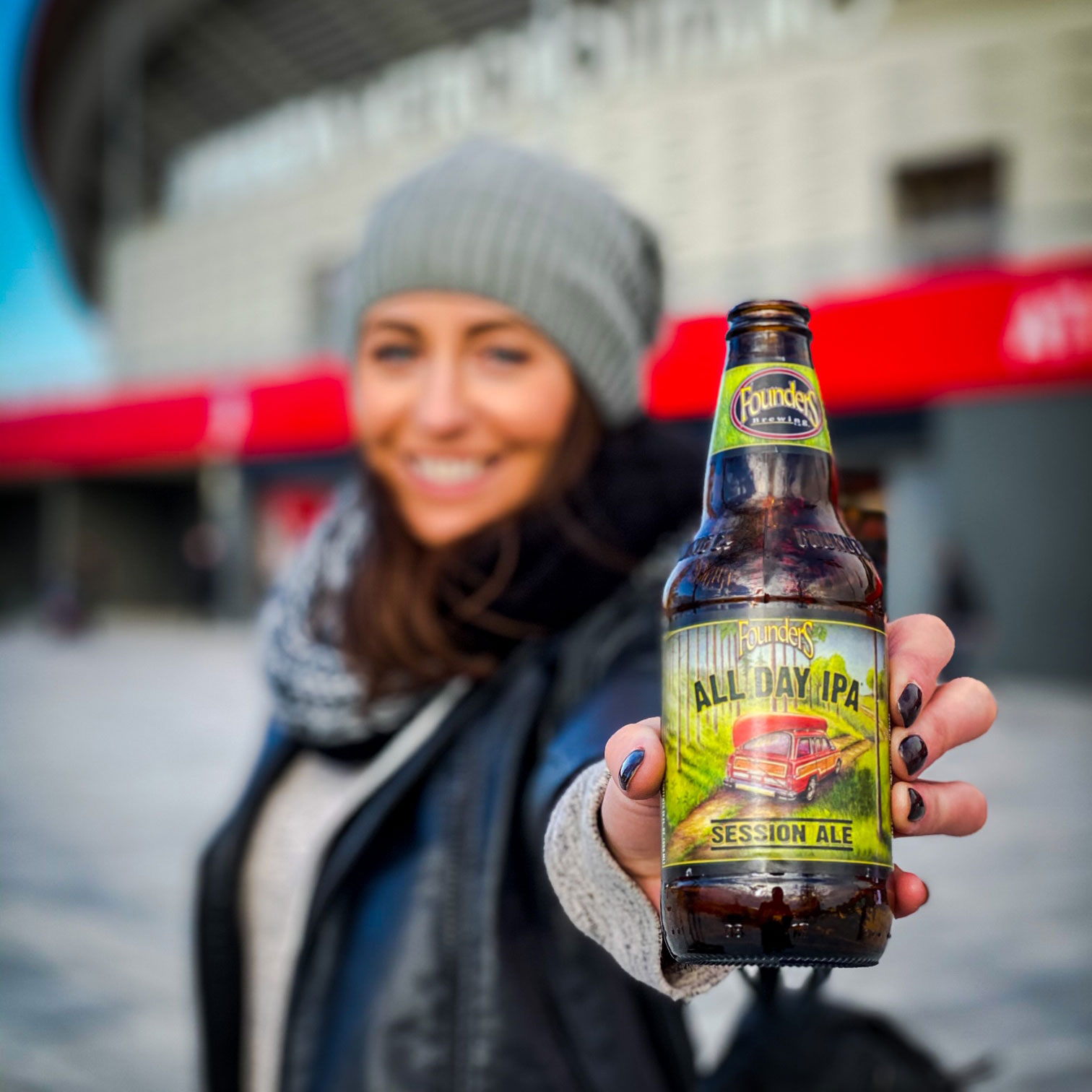 Woman holding bottle of Founders All Day IPA