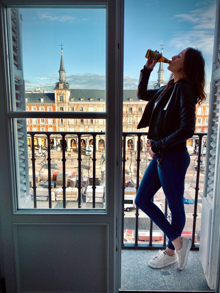 Woman drinking Founders All Day IPA on balcony