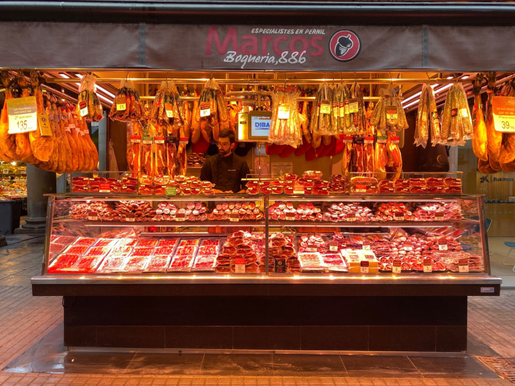 Man working at Marcos Boqueria surrounded by raw meat