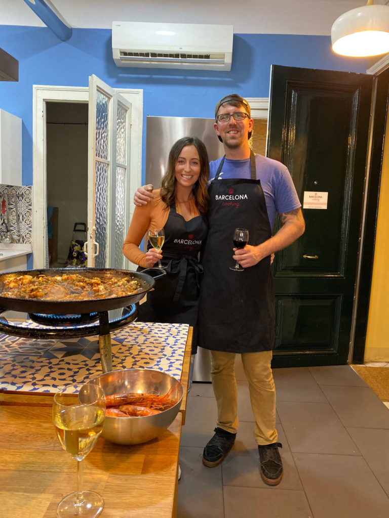 Man and woman drinking wine and cooking