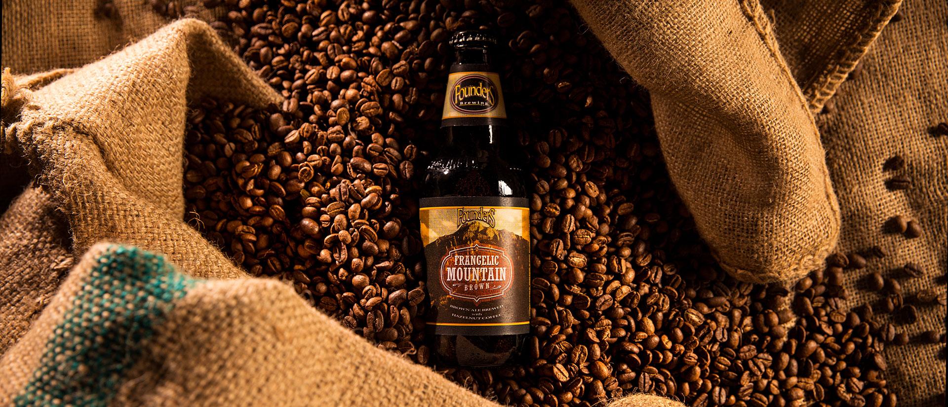 Bottle of Founders Frangelic Mountain Brown sitting in espresso bean s