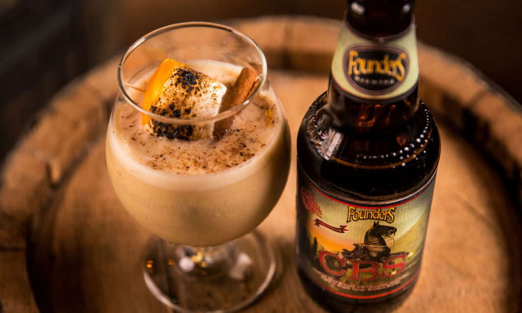 Beer bottle and beer glass filled with Founders CBS egg nog