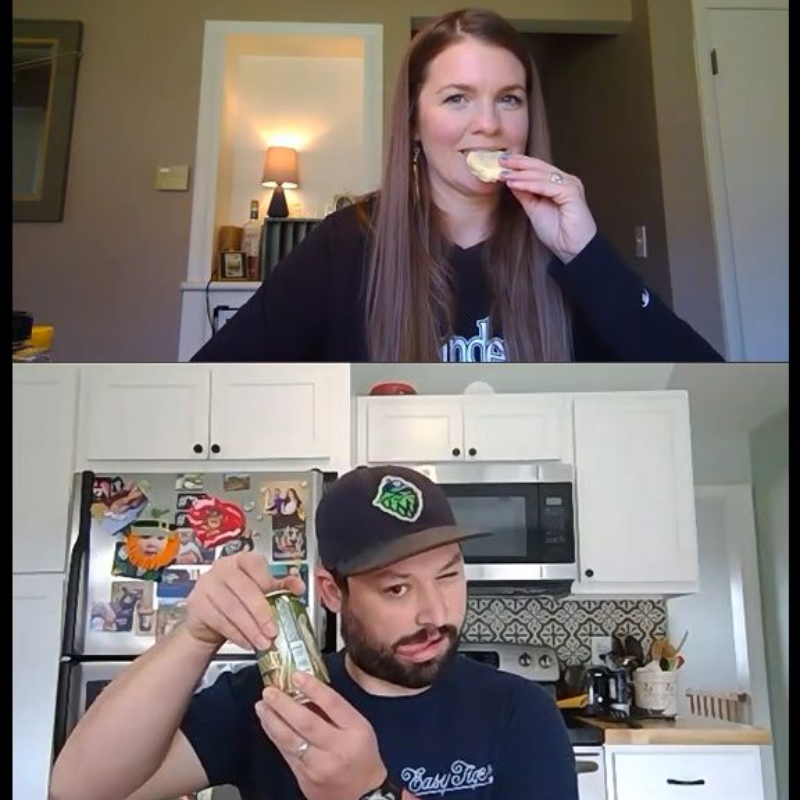 Two people eating and drinking on video call