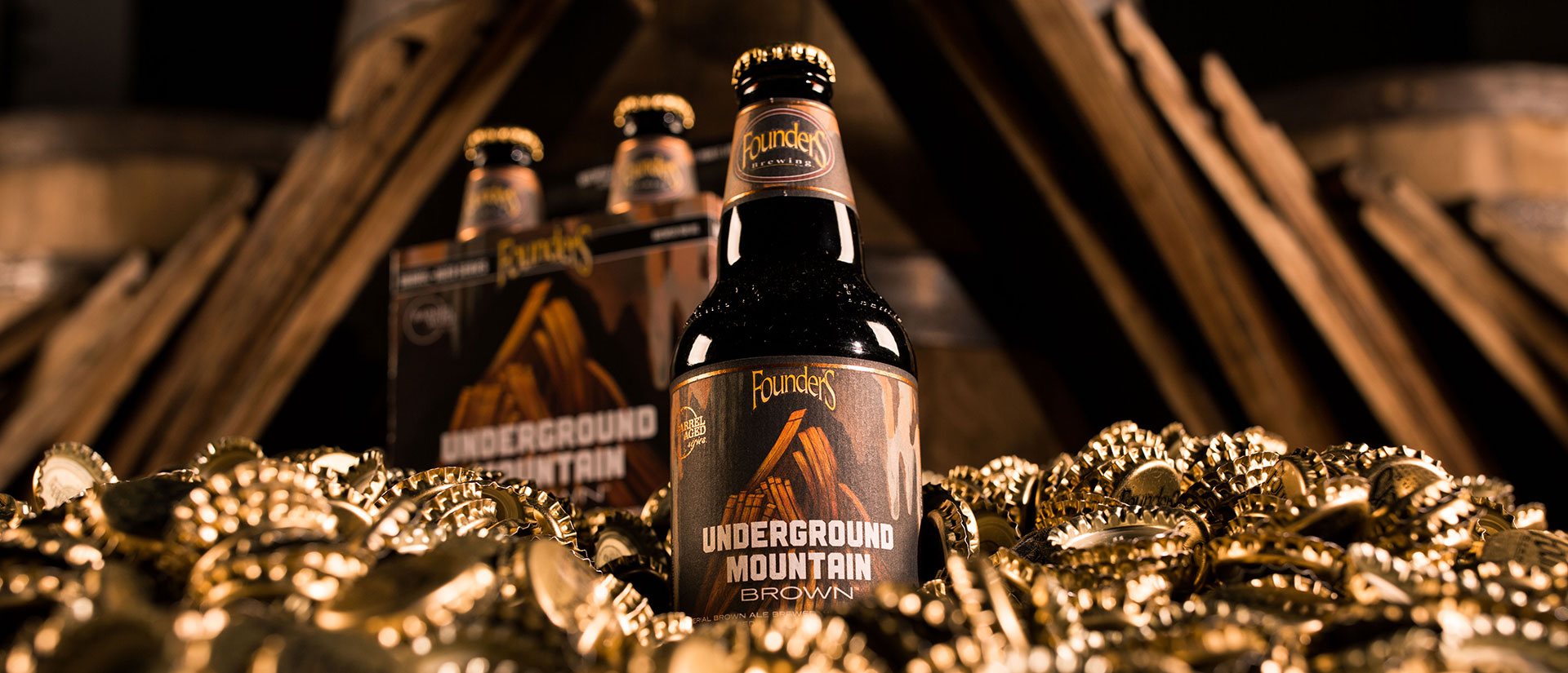 Underground Mountain Brown sitting in gold crowns