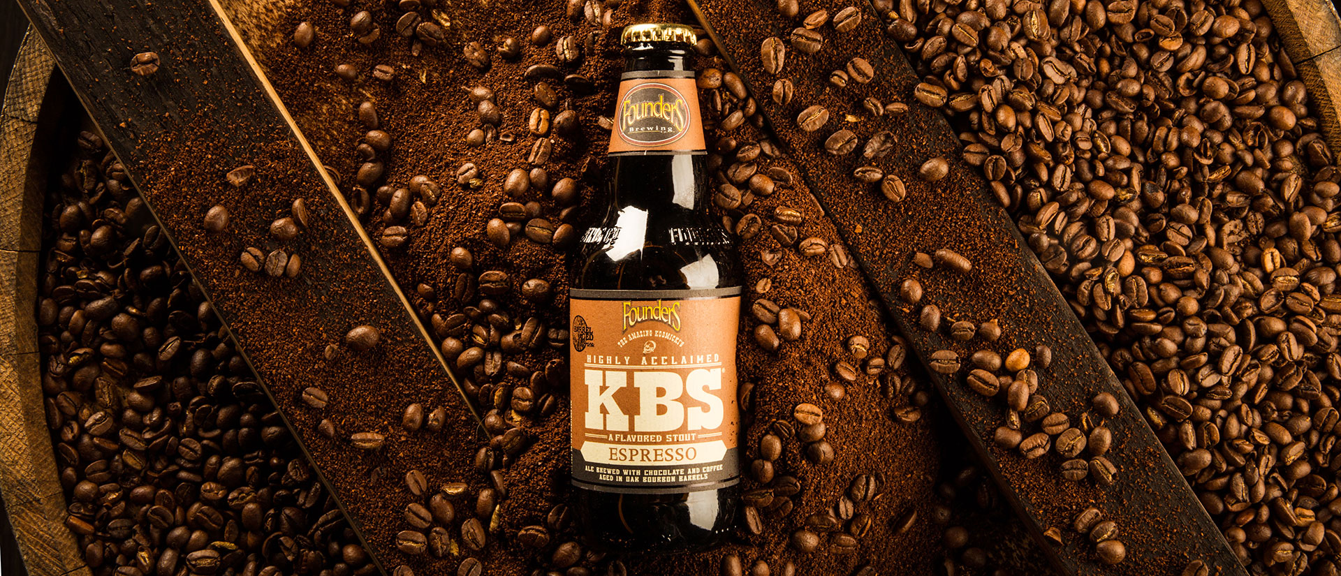 kbs espresso bottle laying on espresso beans