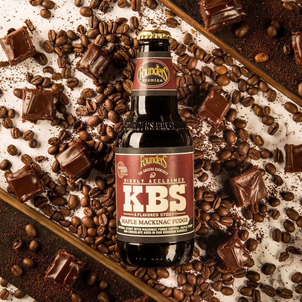KBS Maple Mackinac Fudge bottle surrounded by coffee grounds and chunks of fudge