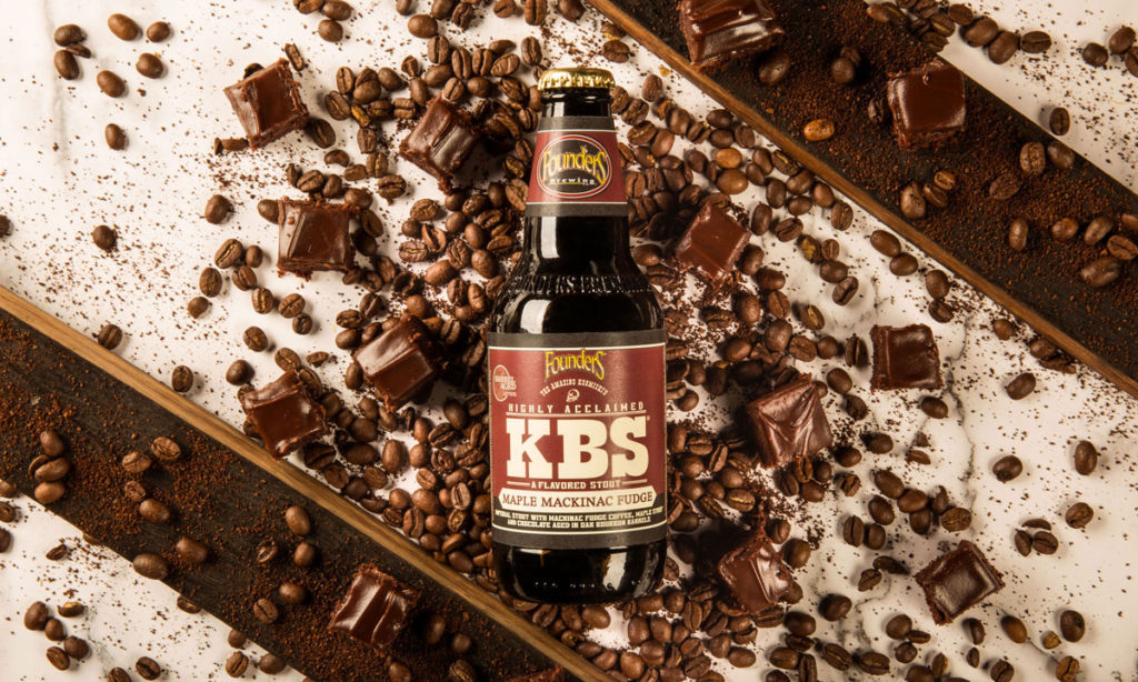 bottle of KBS Maple Mackinac Fudge surrounded by coffee beans and chunks of fudge