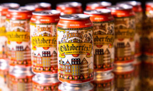 oktoberfest cans arranged in a series on top of a mirror