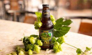 Harvest Ale Bottle Wrapped In Hop Vines