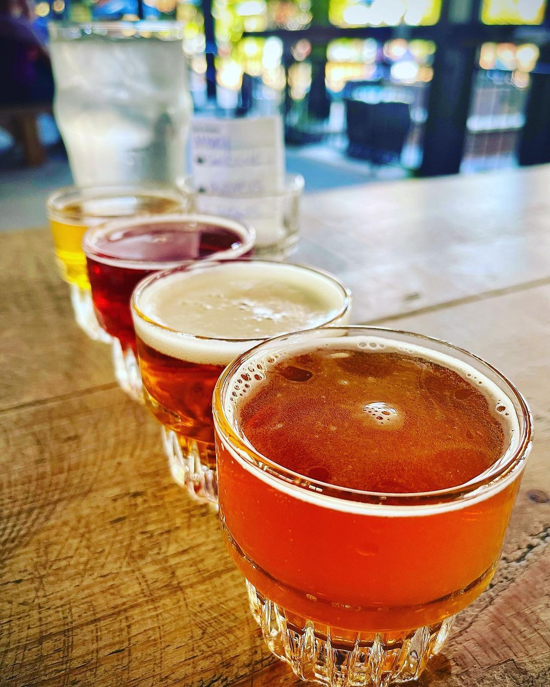 A flight of beer on a table at our Grand Rapids taproom.